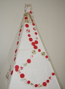 Christmas Garland decorating a teepee