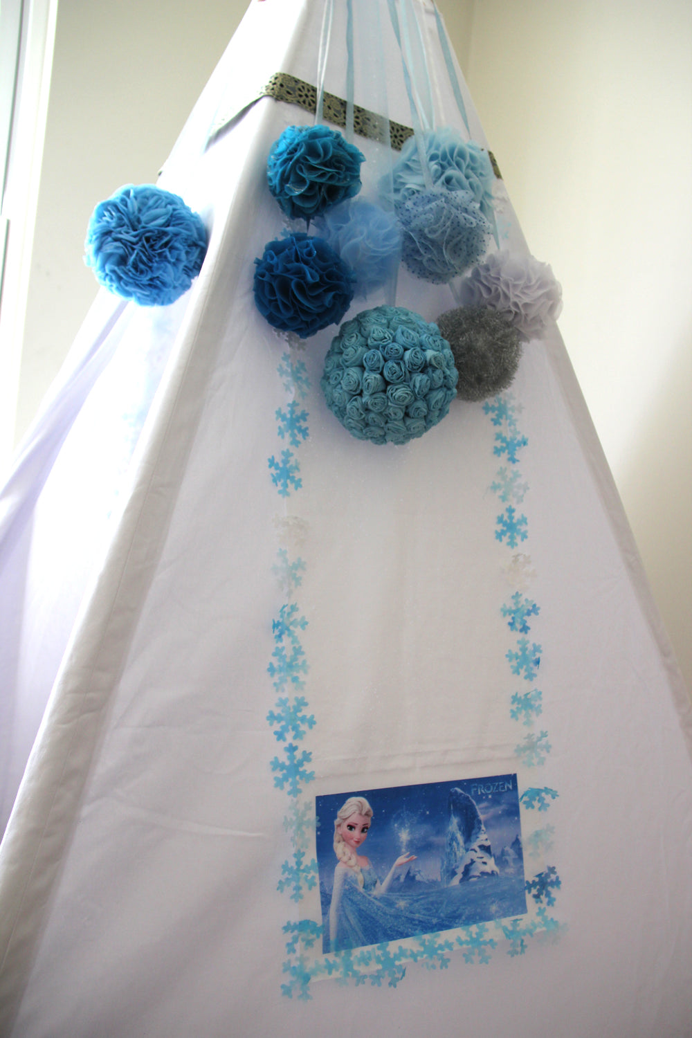 Teepee decorated with fabric snowballs
