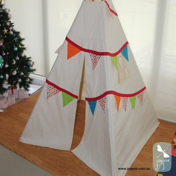 Bright bunting teepee with hedgehog print and solid flags.