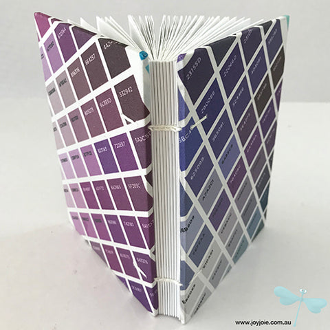 Purple sateen coptic bound sketchbook