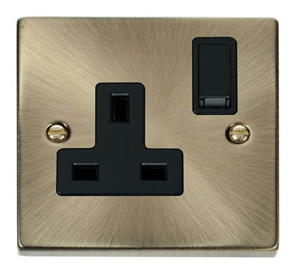 Antique Brass 1 Gang 13A DP Switched Plug Socket - Black Trim