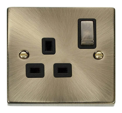 Antique Brass 1 Gang 13A DP Ingot Switched Plug Socket - Black Trim