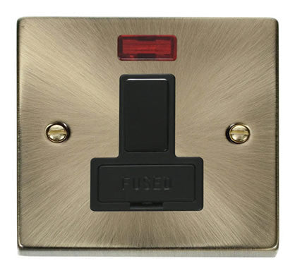 Antique Brass 13A Fused Connection Unit Switched With Neon - Black Trim