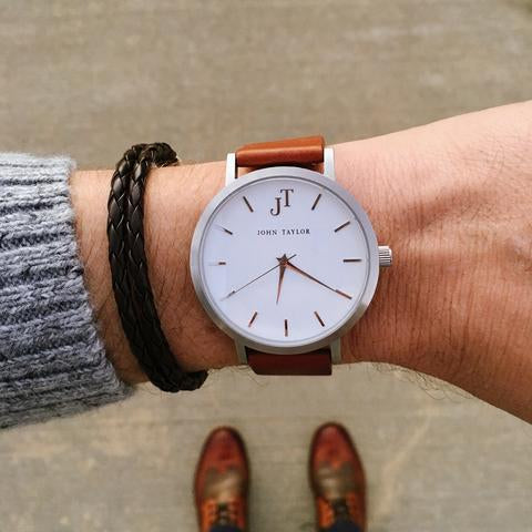 Picture of a hand and the John Taylor Byron watch