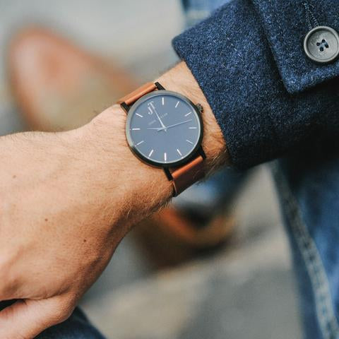 A hand and jacket and the Cottesloe watch John Taylor
