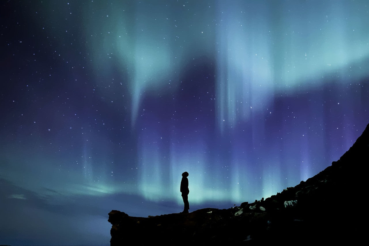 man-looking-up-at-northern-lights-john-taylor-watches-blog-post