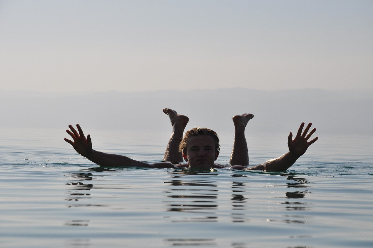 man-floating-in-dead-sea-john-taylor-watches-blog-post