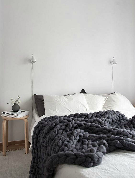 bed with white and grey linen