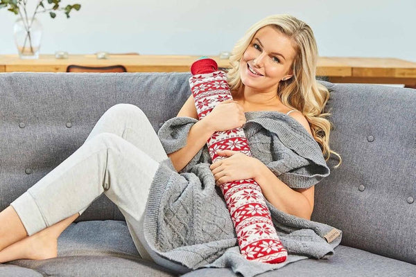 long hot water bottle with red knit cover