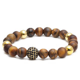 https://www.kingsrush.com/collections/exclusive-design-collection/products/matte-tigers-eye-and-rhodium-plated-ball