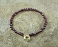 Garnet Stretch Bracelet with Gold filled Hamsa Charm