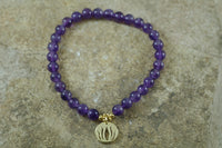 Amethyst Gemstone Bracelet with Gold Lotus Charm Pendant
