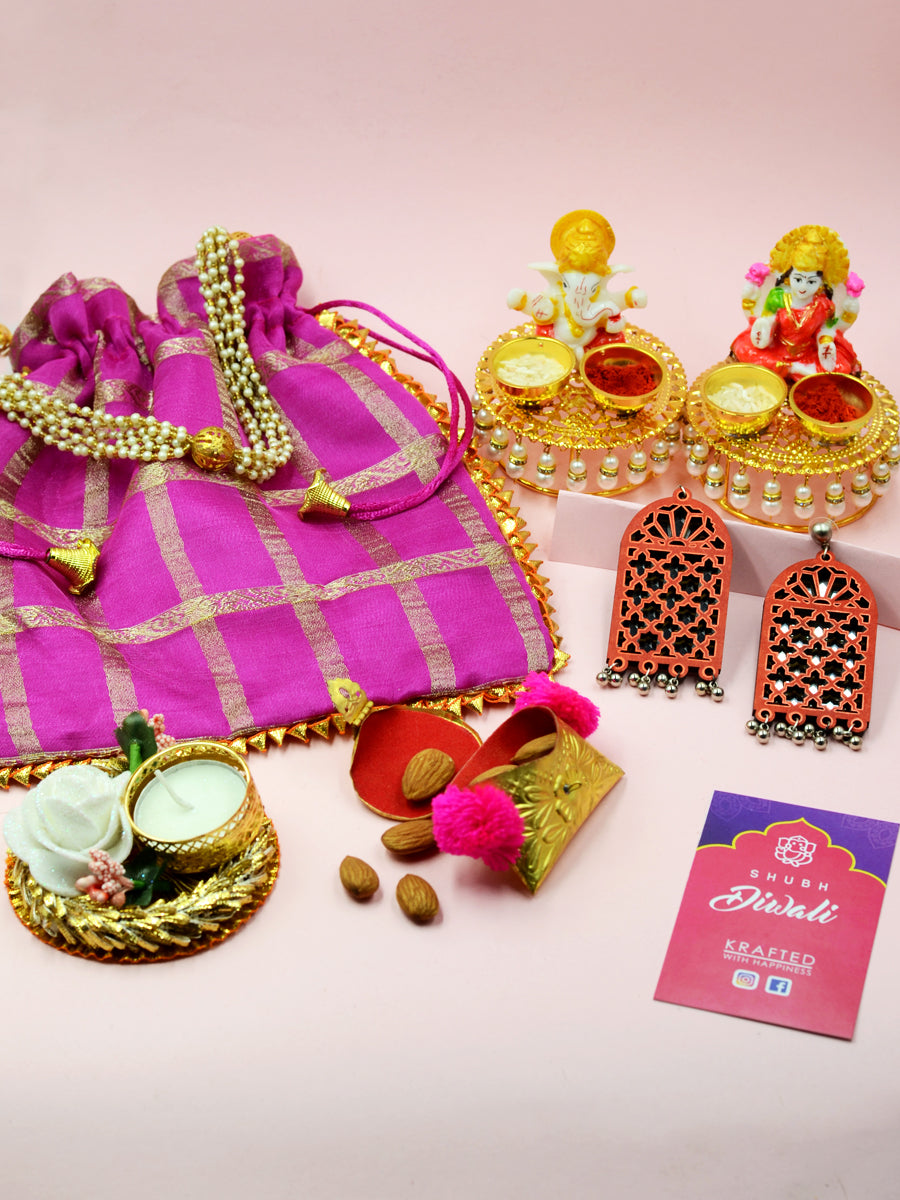 Big Diwali Hamper (Purple), a completely handcrafted Diwali themed combo of a potli pouch, idols, earrings and more from our festive collection of handmade and hand embroidered diwali hampers.