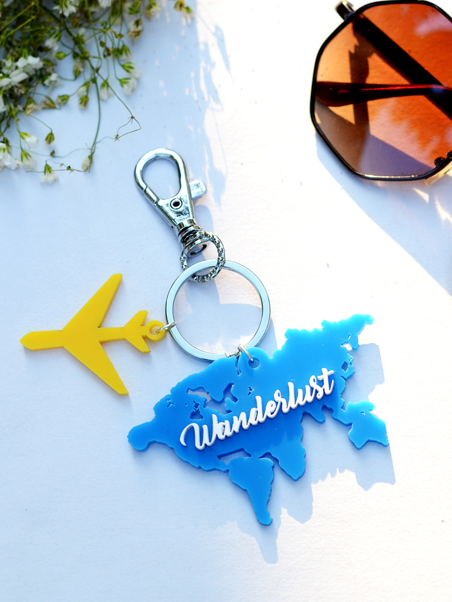Wanderlust Keychain Bagcharm, a unique handcrafted keychain bag charm from our designer collection of hand embroidered statement keychain and bag charms online.