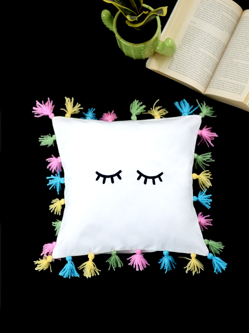 Unicorn Eyes Cushion Cover, a unique hand embroidered cotton cushion cover with tassel detailing from our wide range of quirky, bohemian home decor products like ethnic cushion covers, thread art and more.
