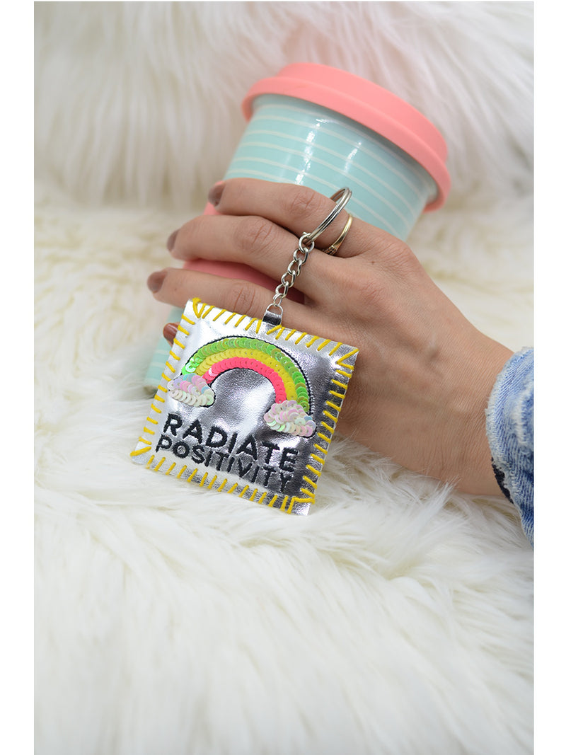 Radiate Positivity Keychain Bagcharm, a unique handcrafted keychain bag charm from our designer collection of hand embroidered statement keychain and bag charms.