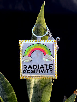 Radiate Positivity Keychain Bagcharm, a unique handcrafted keychain bag charm from our designer collection of hand embroidered statement keychain and bag charms online.