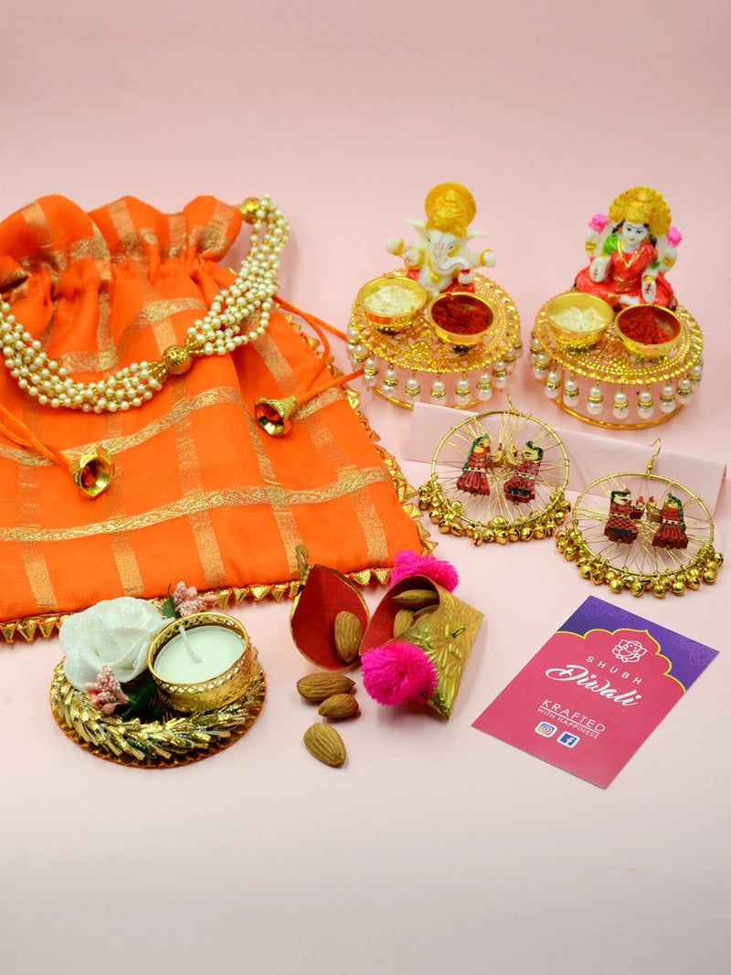 Big Diwali Hamper (Orange), a completely handcrafted Diwali themed combo of a potli pouch, idols, earrings and more from our festive collection of handmade and hand embroidered products online.