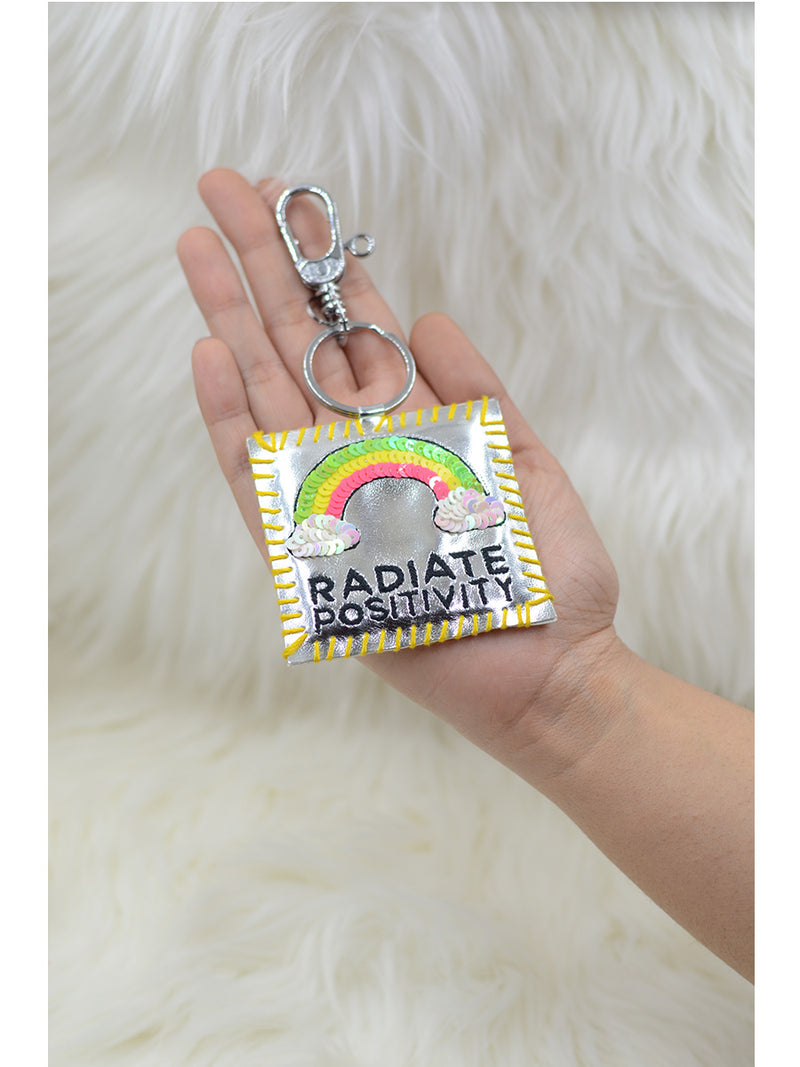 Radiate Positivity Keychain Bagcharm, a handcrafted keychain bag charm from our designer collection of hand embroidered keychain and bag charms online.