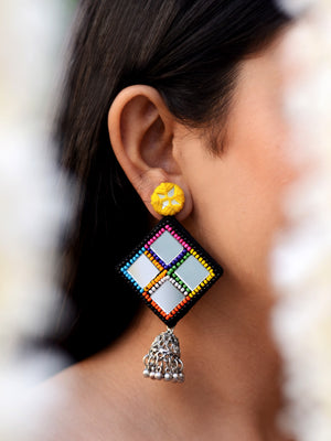 Juhi Hand-embroidered Mirror Jhumkas, a contemporary handcrafted earring from our wedding collection of Kundan, gota patti, pearl earrings and jhumkas for women.