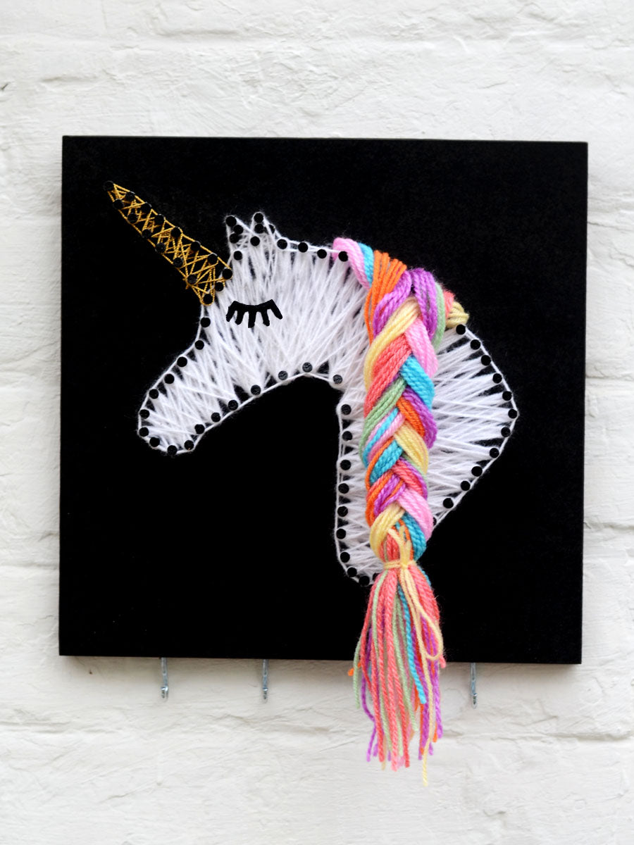Unicorn Key Holder a unique handcrafted key holder cum wall hanging from our wide range of quirky, bohemian home decor products like key holders, sunglass holders, wall hangings, thread art and more.