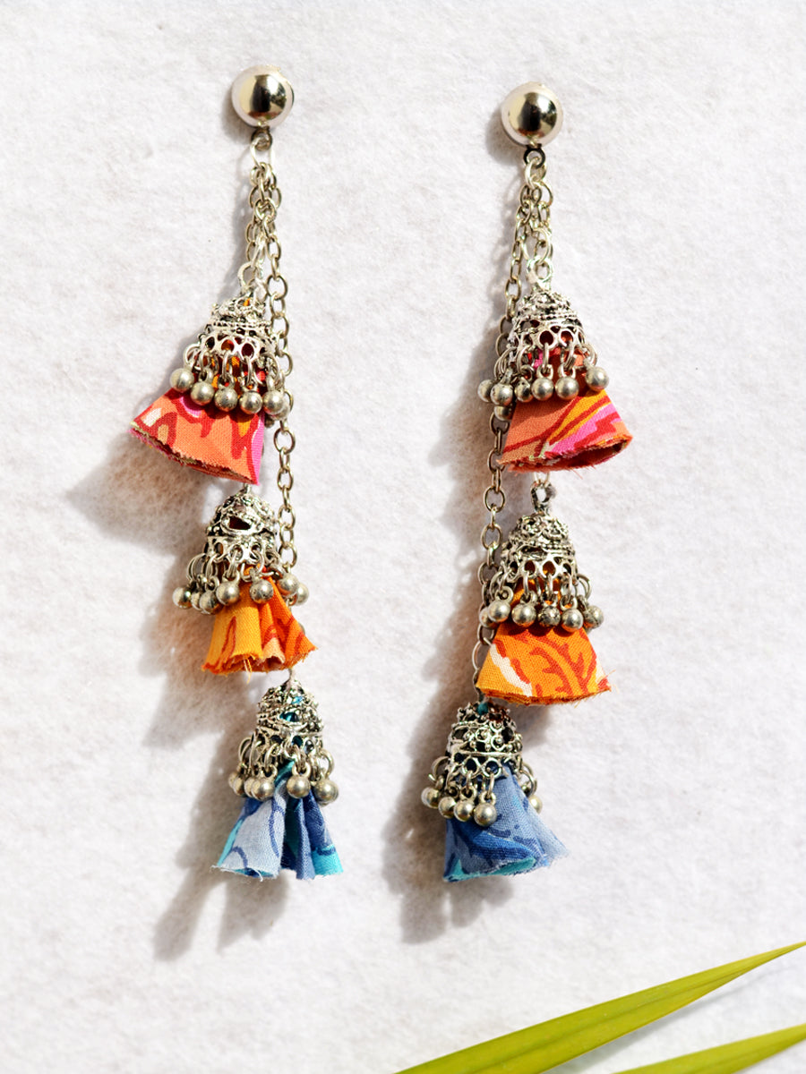 Ada Tassel Jhumka, a beautiful silver ethnic jhumka with hand made cloth tassel from our designer collection of earrings for women online.