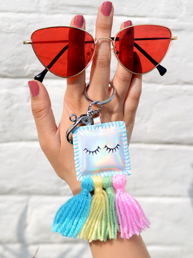 Unicorn Eyelashes Keychain Bagcharm, a unique handcrafted keychain bag charm with tassel detailing from our designer collection of hand embroidered keychain and bag charms online.