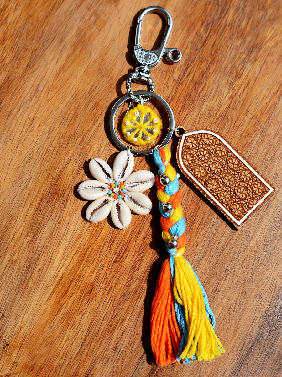 Boho Shell Keychain Bagcharm, a unique handcrafted keychain bag charm with shells, beads and mirror detailing from our designer collection of hand embroidered keychain and bag charms online.