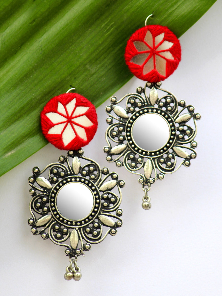 Noor Hand-embroidered Mirror Earrings, an embroidered mirror earring with silver bohemian motif from our quirky designer collection of earrings for women online.