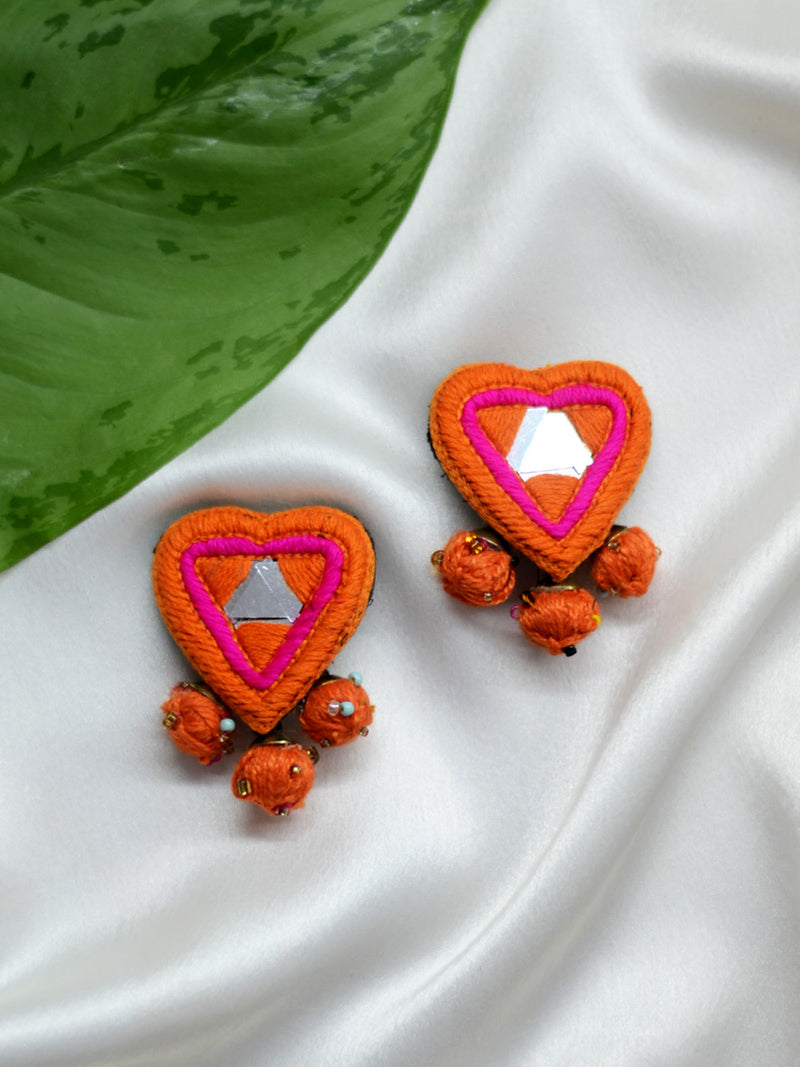 Dil Deewana Earrings, a heart shaped embroidered mirror earring with handcrafted beaded yarn balls from our designer collection of earrings for women online.