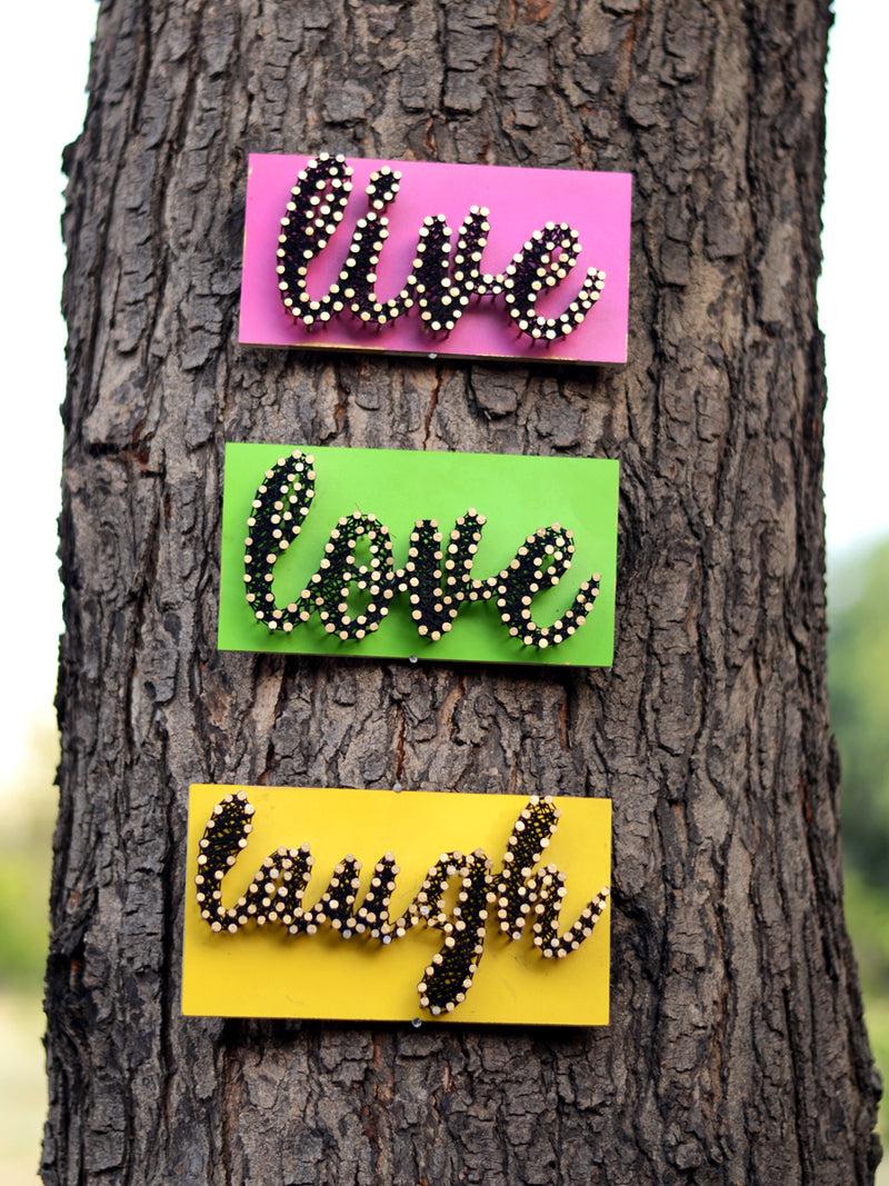 Live Love Laugh Thread Art, a unique handcrafted thread art from our wide range of quirky, bohemian home decor products like cushion covers, wall decor & wall art, wooden coasters, keychain holders and more.