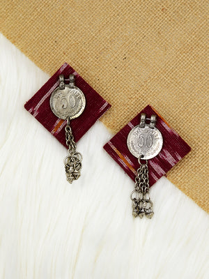 Antique Coin Ikat Earrings, a handcrafted antique coin earring with handmade ikat base and ghungroo detailing from our bohemian collection of earrings for women online.