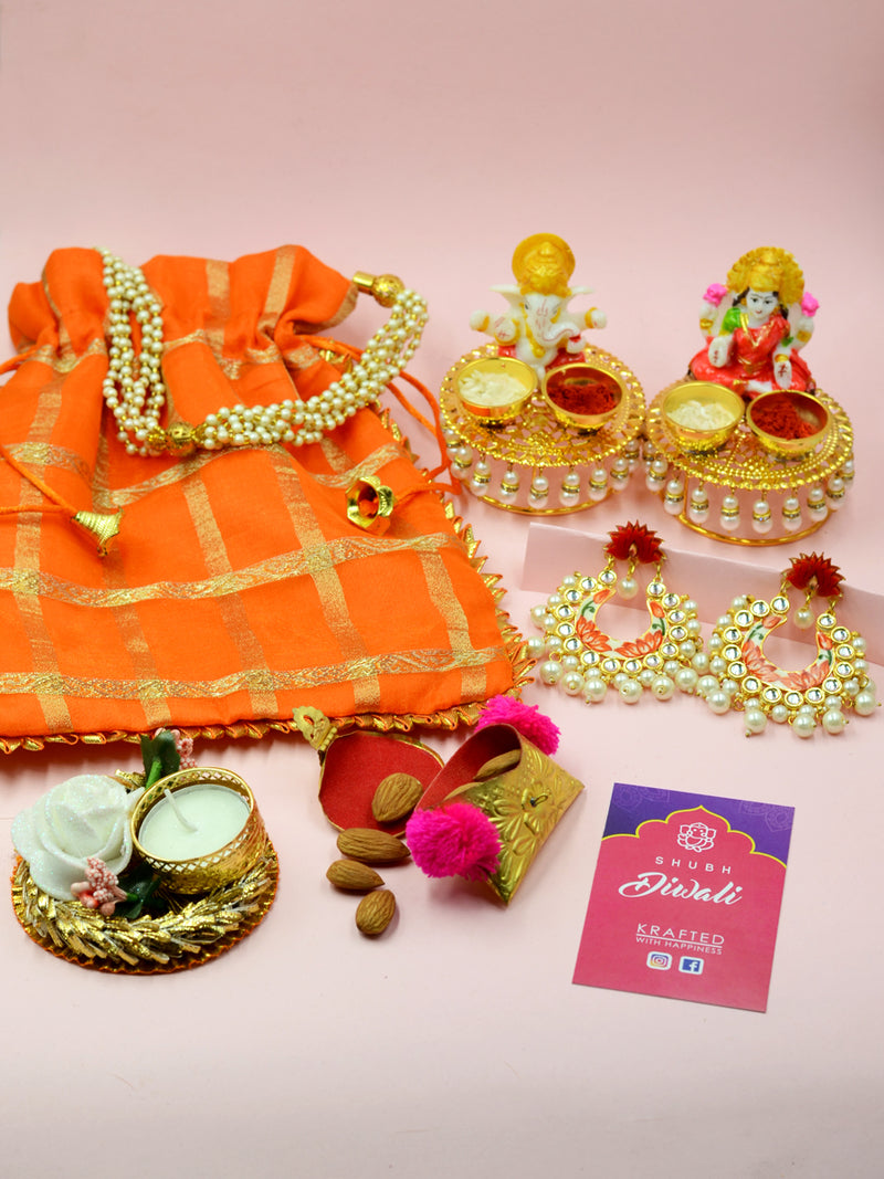 Big Diwali Hamper (Orange), a completely handcrafted Diwali themed combo of a potli pouch, idols, earrings and more from our festive collection of handmade and hand embroidered diwali hampers.