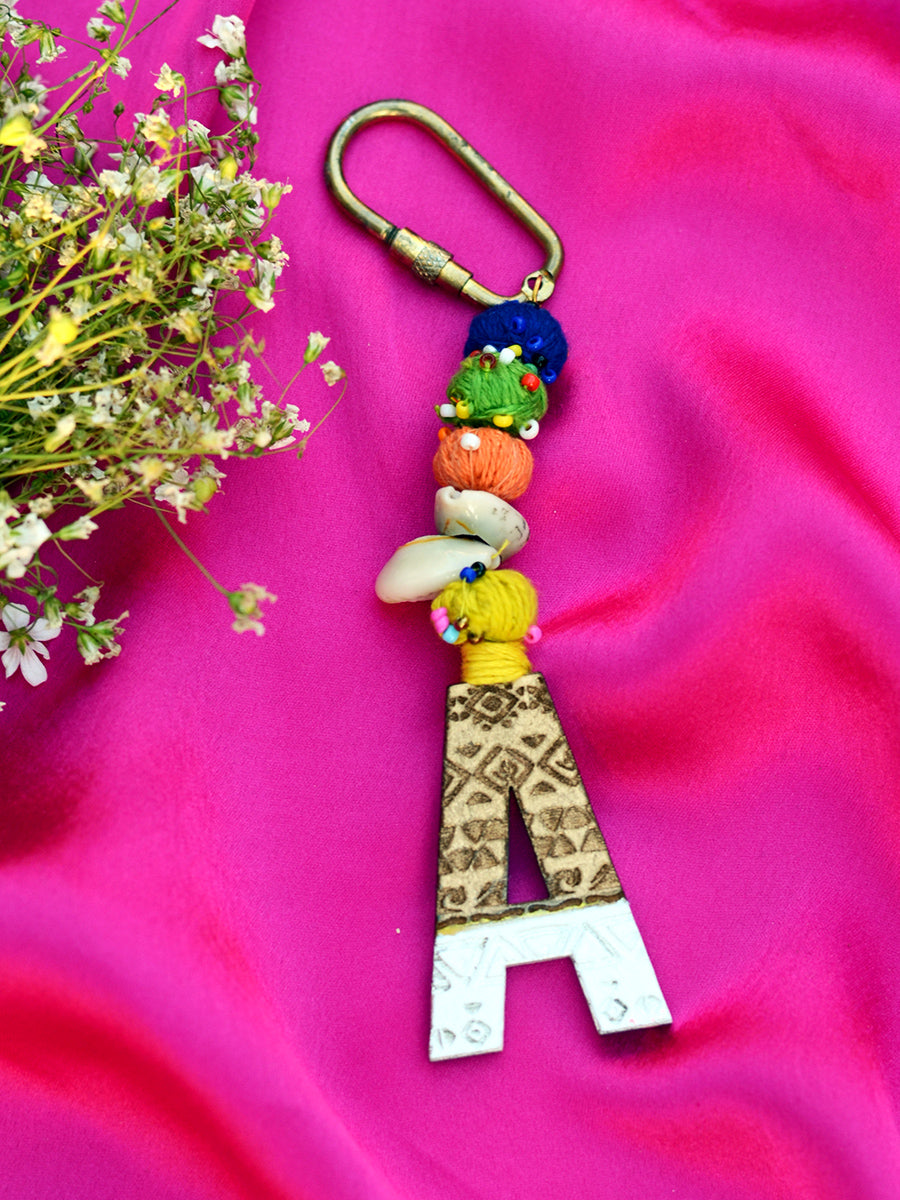 Boho Alphabet Keychain Bagcharm, a unique handcrafted keychain bag charm from our designer collection of hand embroidered keychain and bag charms online.