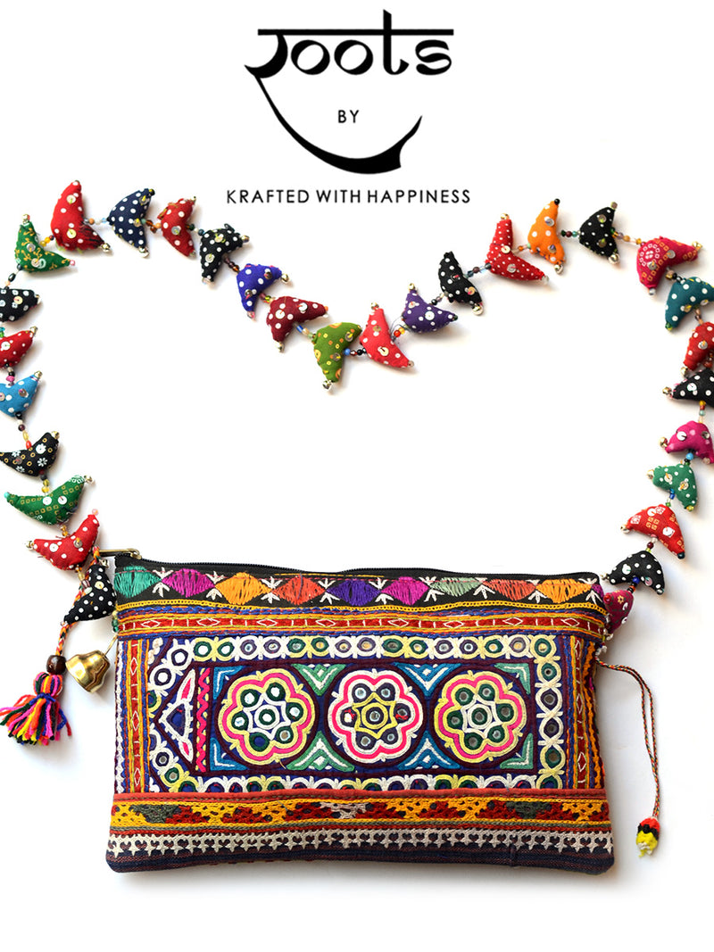 Earthy Goodness Bag 90, a handcrafted boho chic sling bag from our wide range of vintage hand embroidered tassel bags for women online.