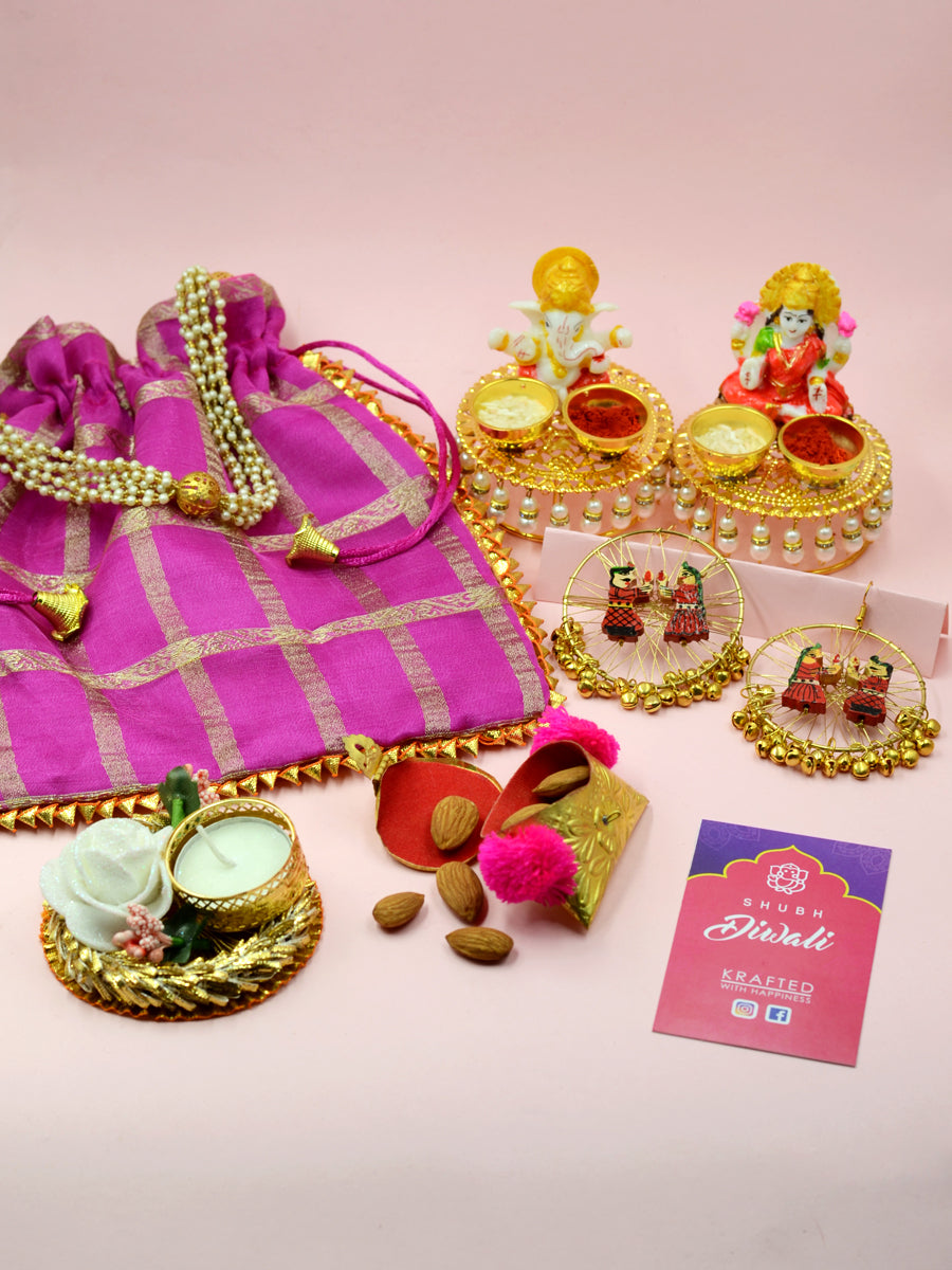 Big Diwali Hamper (Purple), a completely handcrafted Diwali themed combo of a potli pouch, idols, earrings and more from our festive collection of handmade and hand embroidered products online.