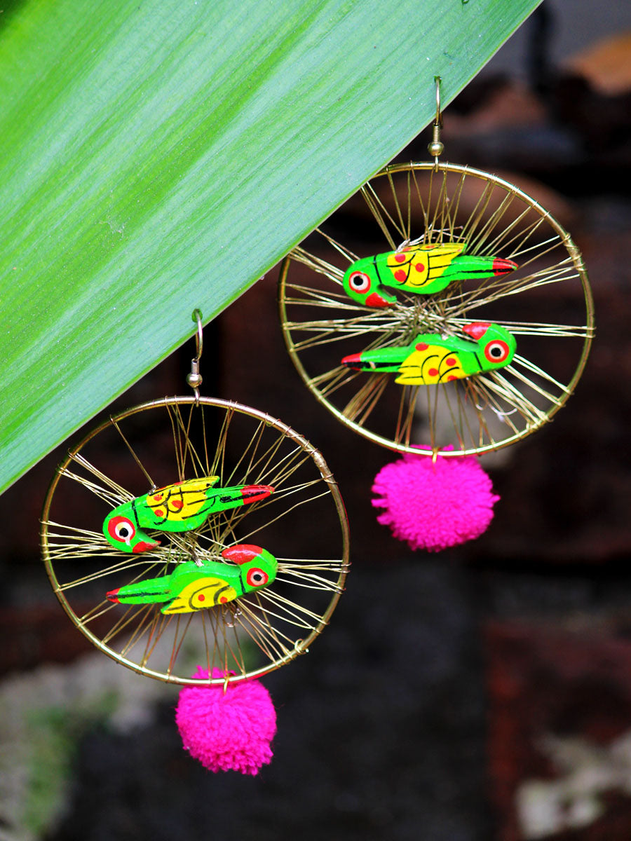 Parrot Paradise, an exclusive designer Indian pom pom earring with hand painted parrots from our designer collection of earrings for women online.