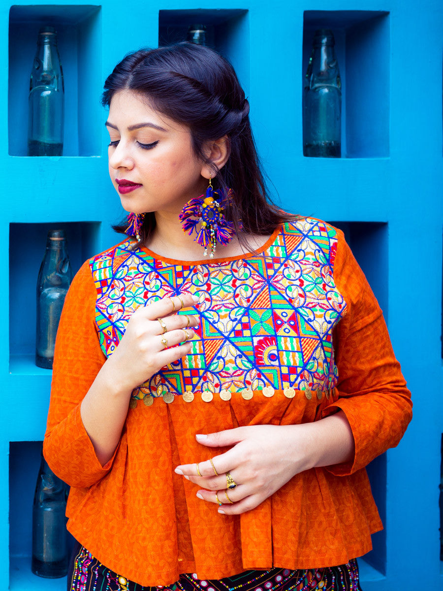Adah Box Pleat Top (Orange), a quirky boho hand embroidered top with coin detail from our designer collection of tops for women.