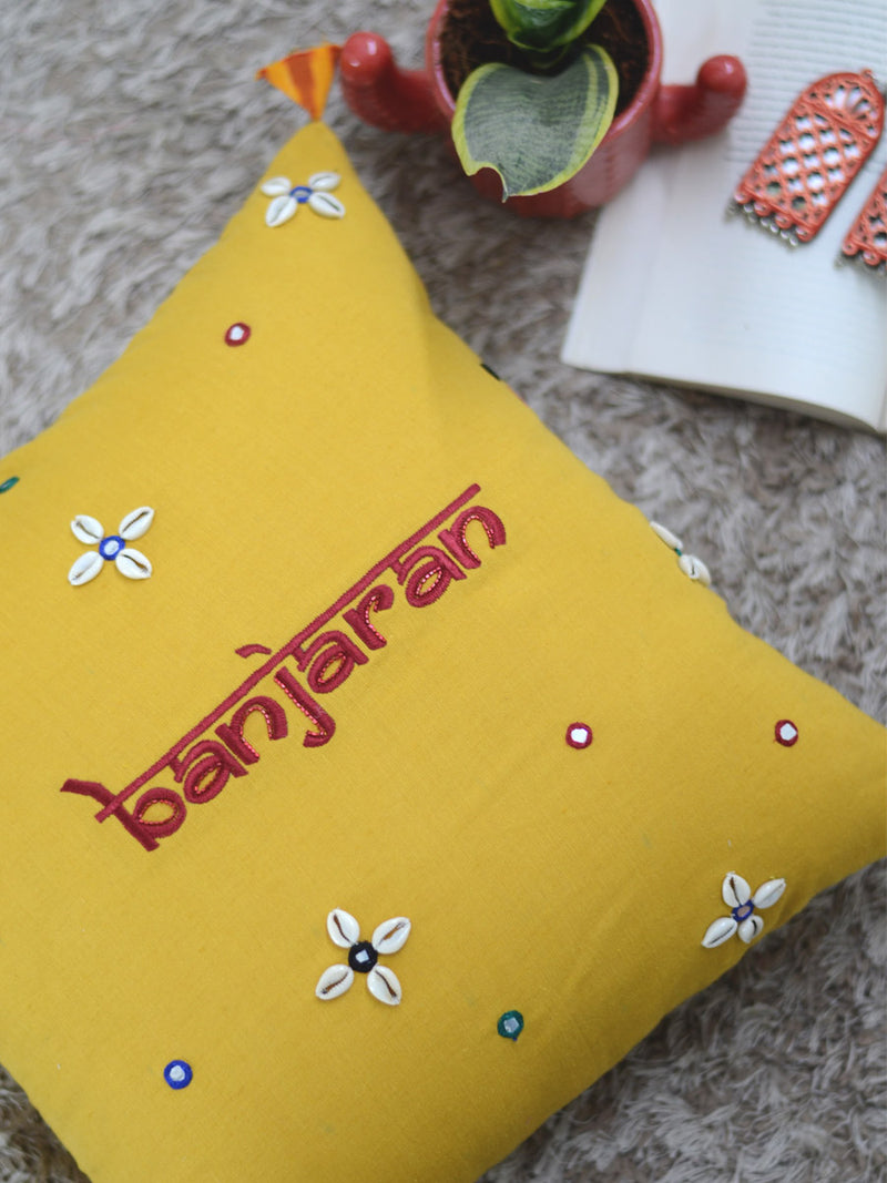 Banjaran Cushion Cover, a unique hand embroidered cotton cushion cover with shell, mirror and tassel detailing from our wide range of quirky, bohemian home decor products like ethnic cushion covers, thread art and more.