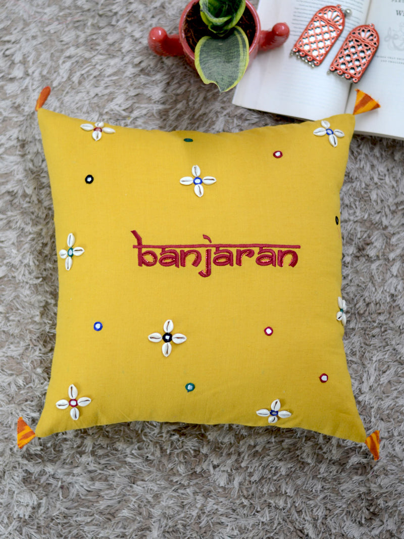 Banjaran Cushion Cover, a hand embroidered cotton cushion cover with shell, mirror and tassel detailing from our wide range of bohemian home decor products like ethnic cushion covers, thread art and more.