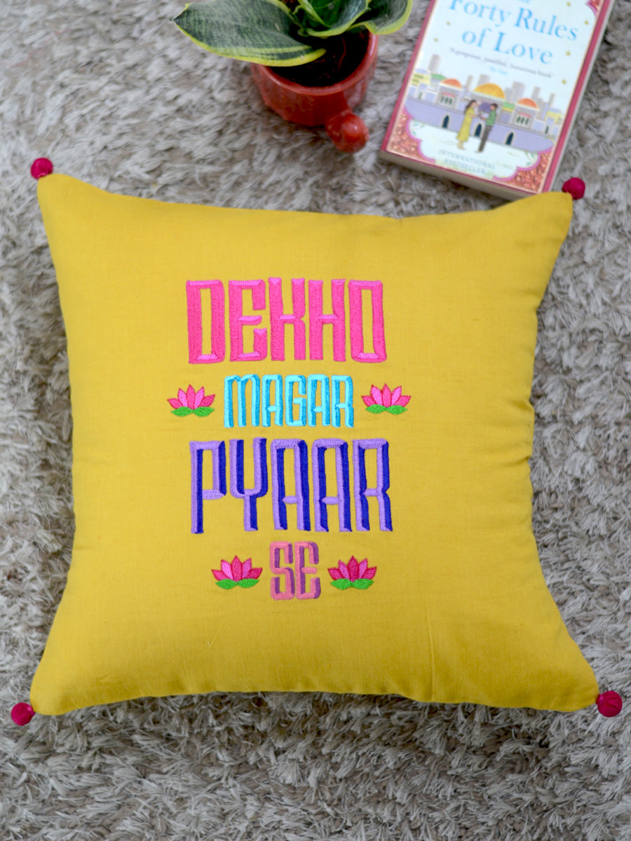 Dekho Magar Pyaar Se Cushion Cover, a hand embroidered cotton cushion cover with pom pom detailing from our wide range of bohemian home decor products like ethnic cushion covers, thread art and more.