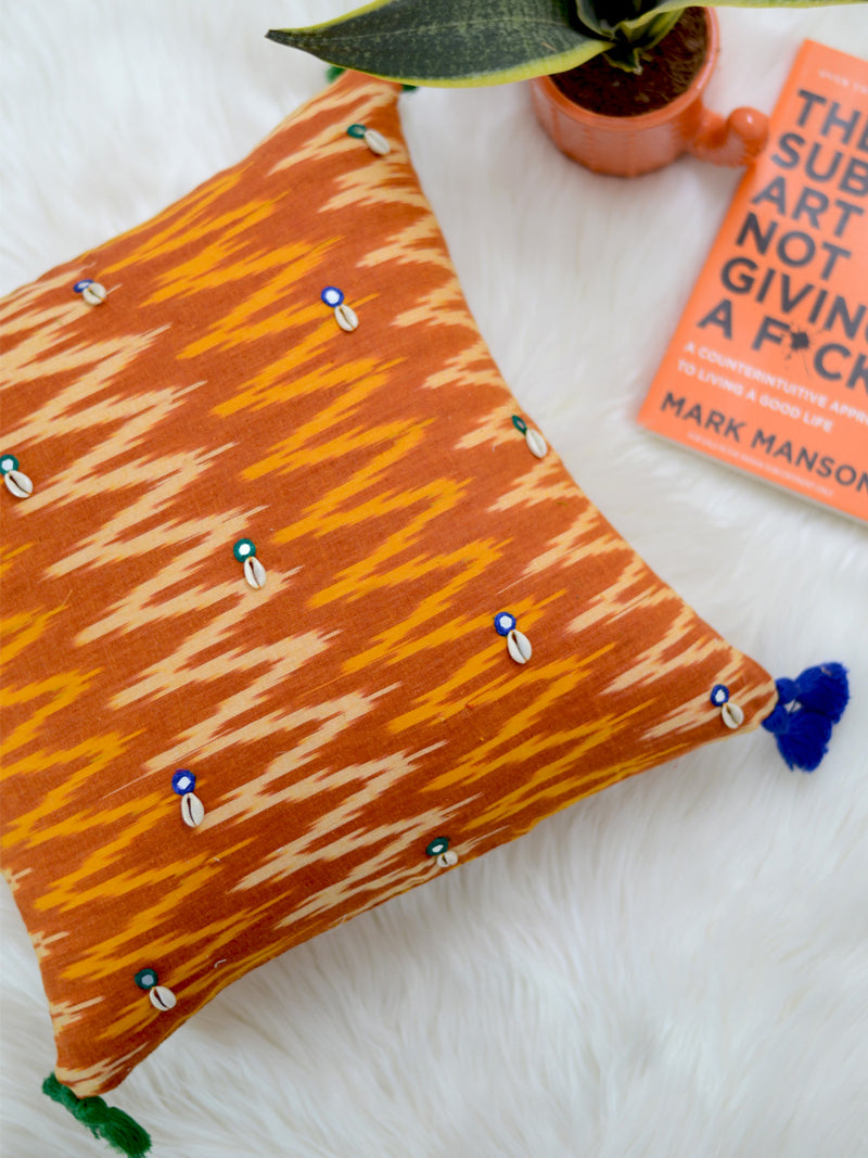 Growth Cushion Cover (Orange/Mustard), a unique hand embroidered cotton cushion cover with mirror and tassel detailing from our wide range of quirky, bohemian home decor products like ethnic cushion covers, thread art, wall decor & wall art, keychain holders and more.
