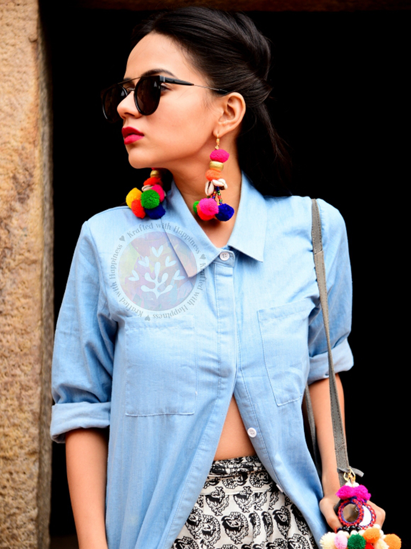 Bohemian Crush Earrings, a handcrafted multicolor pom pom earrings from our designer collection of earrings for women.