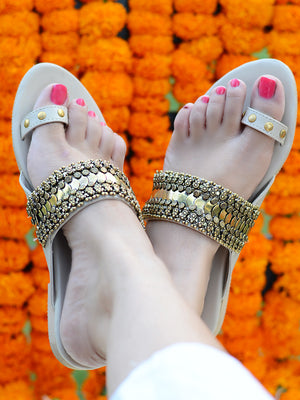 Nusrat Kolhapuris, from our sassy range of ethnic kohlapuri footwear for women, to create a banjara, bohemian look.