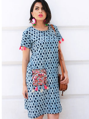 Meera Indigo Dress, a hand embroidered ultra chic dress with tassels and shells from our latest designer collection of boho and ethnic dresses for women online.