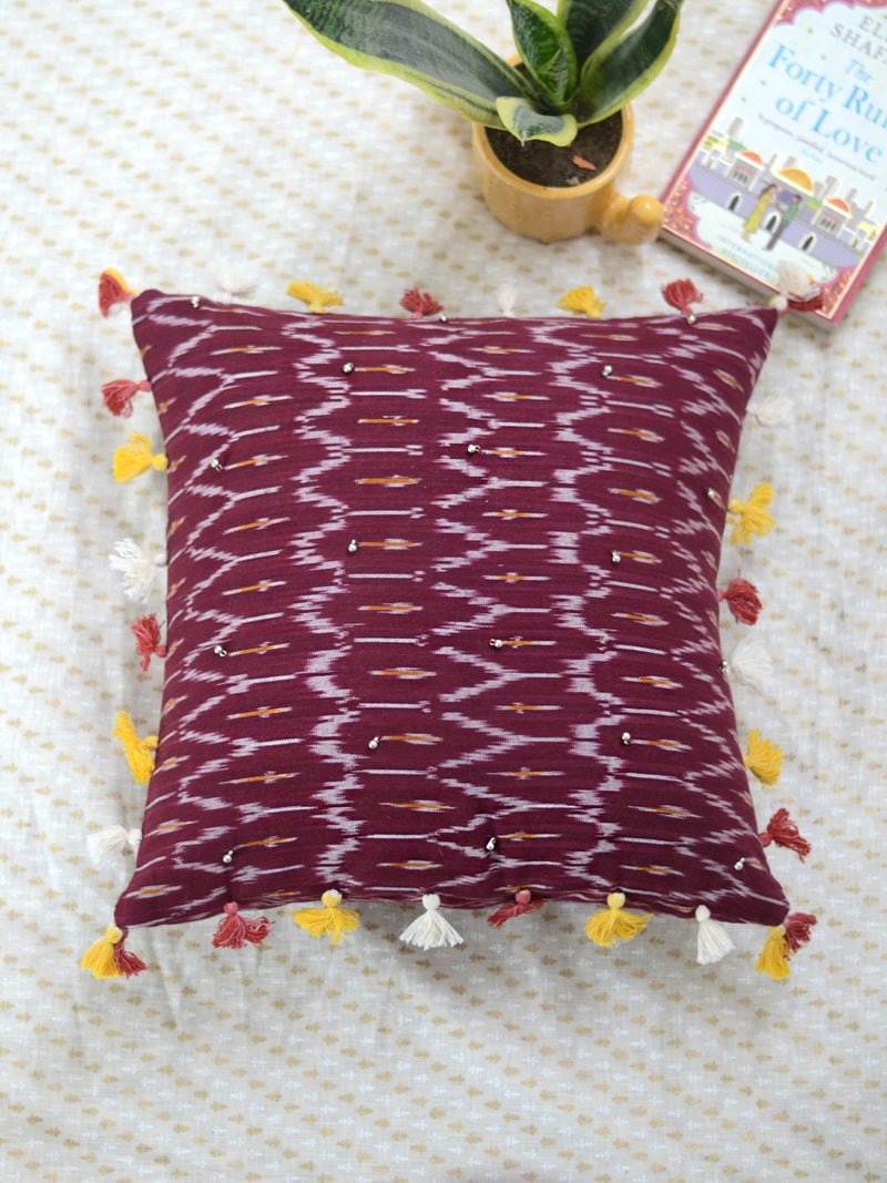 Prosperity Cushion Cover (Maroon), a hand embroidered cotton cushion cover with soundless ghungroo and tassel detailing from our wide range of bohemian home decor products like ethnic cushion covers, thread art and more.