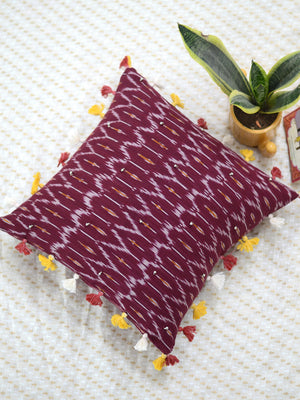 Prosperity Cushion Cover (Maroon), a unique hand embroidered cotton cushion cover with soundless ghungroo and tassel detailing from our wide range of quirky, bohemian home decor products like ethnic cushion covers, thread art, wall decor and more.