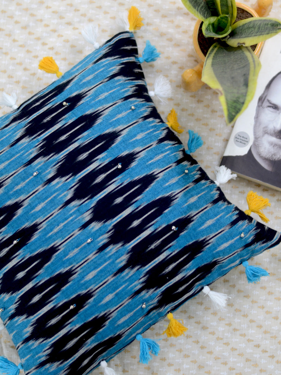 Zen Cushion Cover (Blue/Black), a unique hand embroidered cotton cushion cover with ghungroo and tassel detailing from our wide range of quirky, bohemian home decor products like ethnic cushion covers, thread art, wall decor & wall art and more.