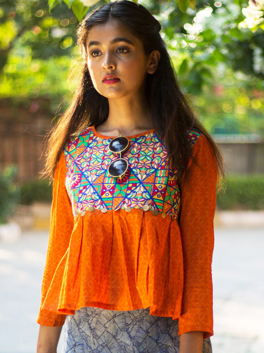 Adah Box Pleat Top (Orange), a quirky boho hand embroidered top with coin detail from our latest designer collection of tops for women online.