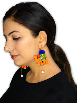 Elephant Pop earrings, a hand painted designer pom pom earrings from our quirky collection of earrings for women.